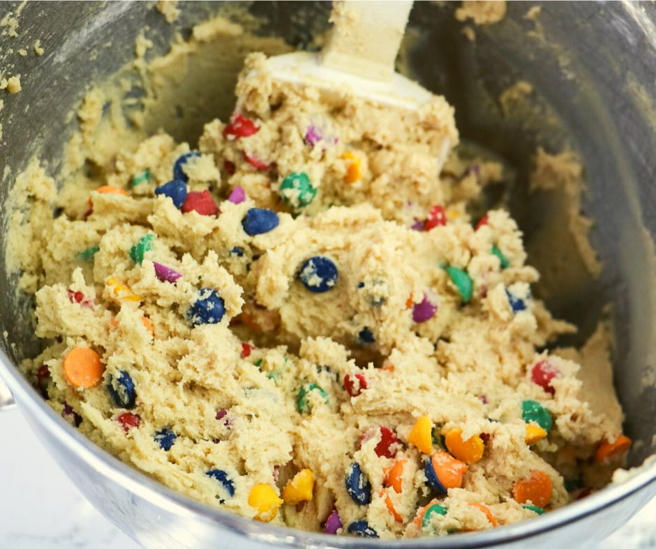 cookie dough with rainbow chips in a mixing bowl