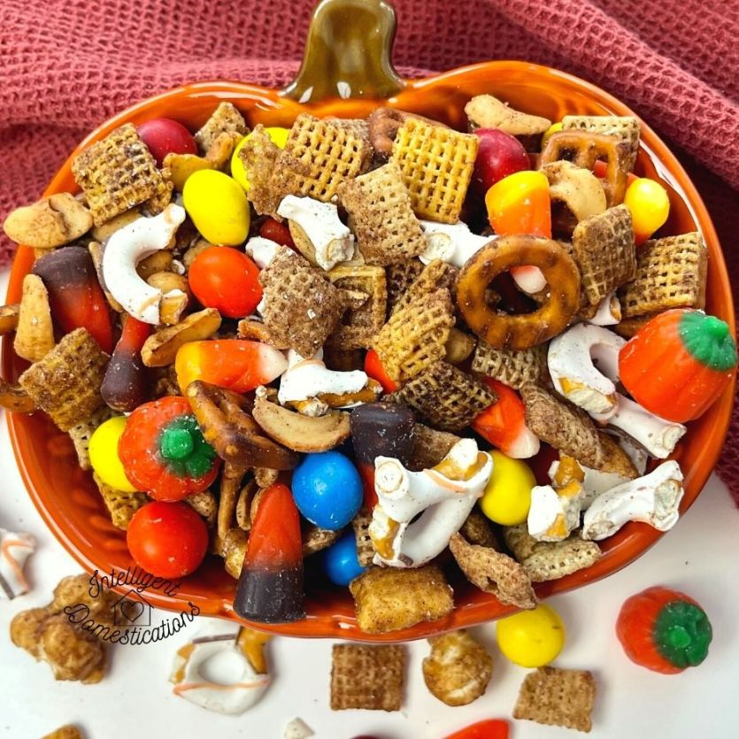 Fall Harvest Chex Mix served in an orange pumpkin shape bowl