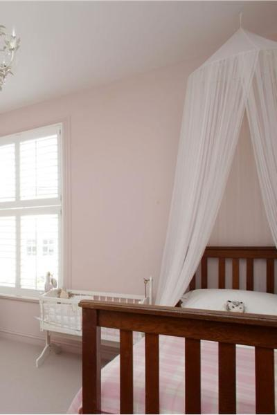 Farrow and Ball, Girl's bedroom painted in Calamine Estate Emulsion.