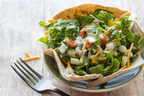 image of quick & healthy taco salad by cindy newland with intentionally eat in a green bowl with a fork next to it