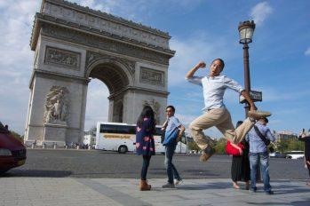 Jumping Jedd, Arc de Triomphe, Paris   Intentional Travelers
