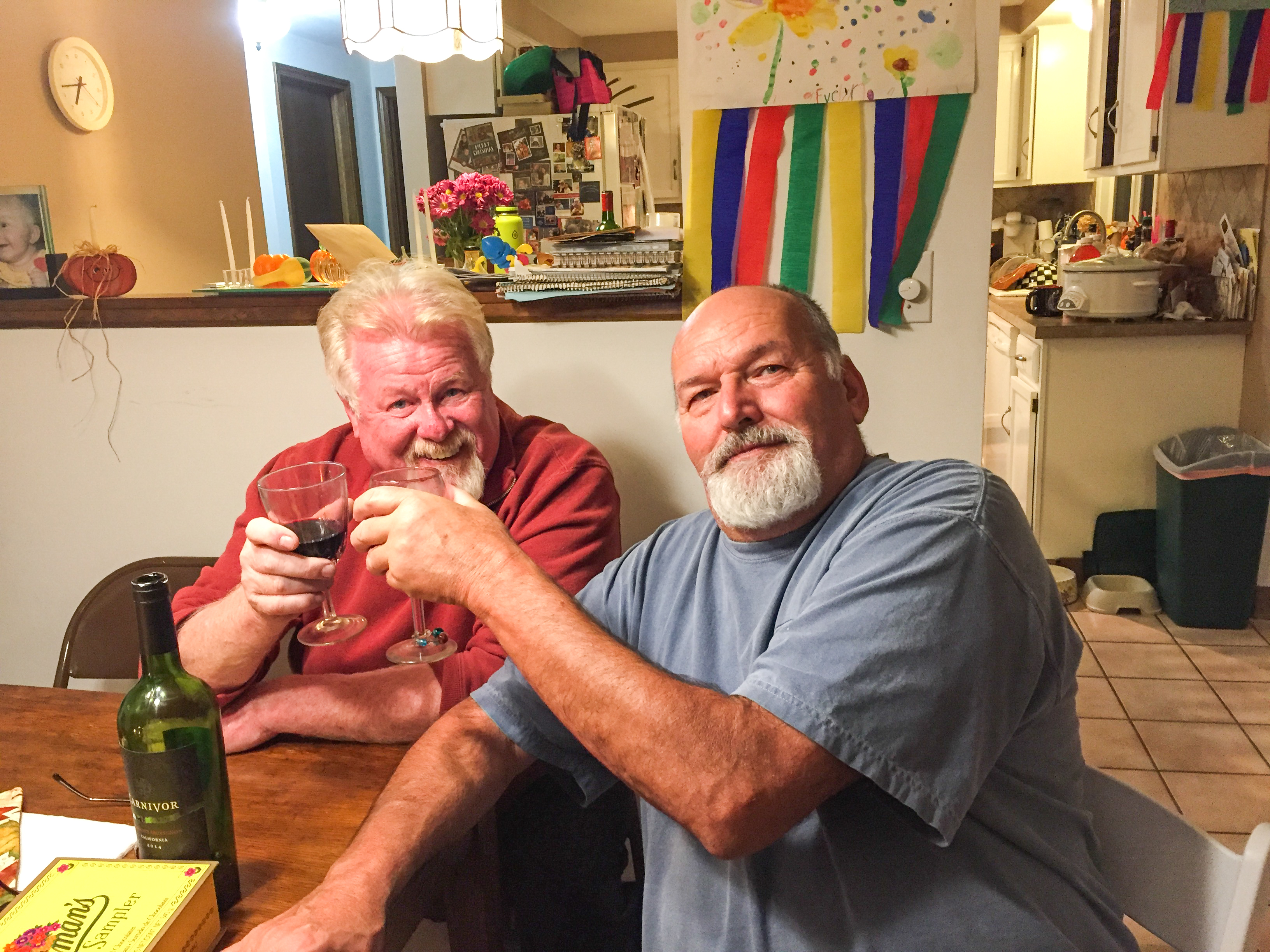 My father and uncle clinking glasses around the holidays
