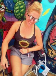 Taylor Swope in the Little Hippie booth at Gathering of the Vibes 2014