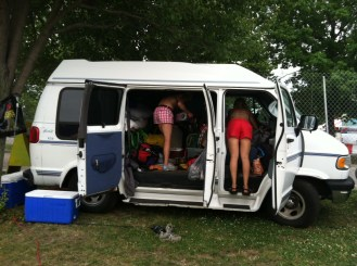 Unpacking the van at Gathering of the Vibes in 2012