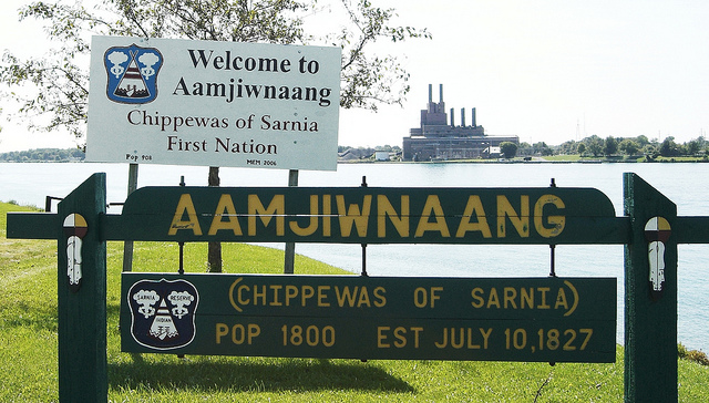 Toban Black/flickr. The Anishinaabe people from Aamjiwnaang First Nation are surrounded by heavy industry.