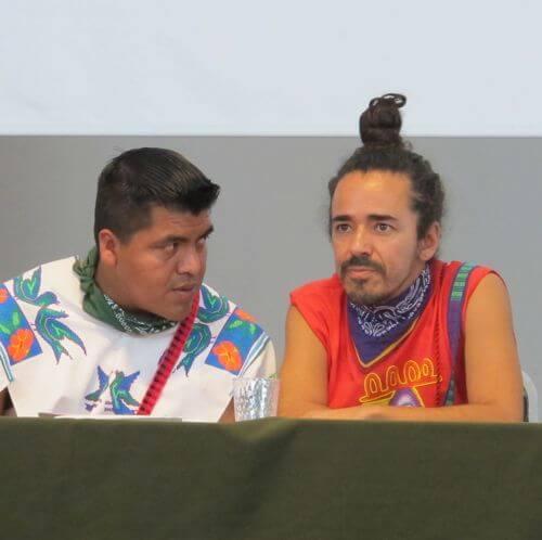 Wixarika leader Santos de la Cruz consults with Ruben Albarran of Café Tacuba in a May 2012 press conference right before Wirikuta Fest.