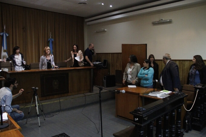 Reina Maraz - in blue - with her defense lawyer and interpreter in court November 2014. Credit - Agencia ANDAR