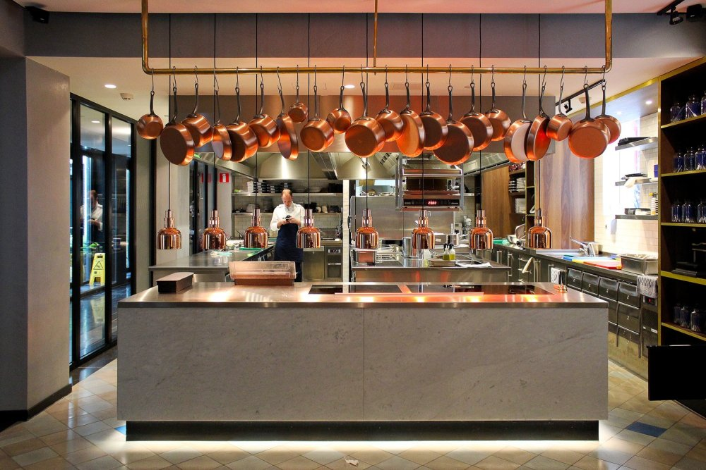 Concrete and copper open kitchen at the Pressroom Restaurant.