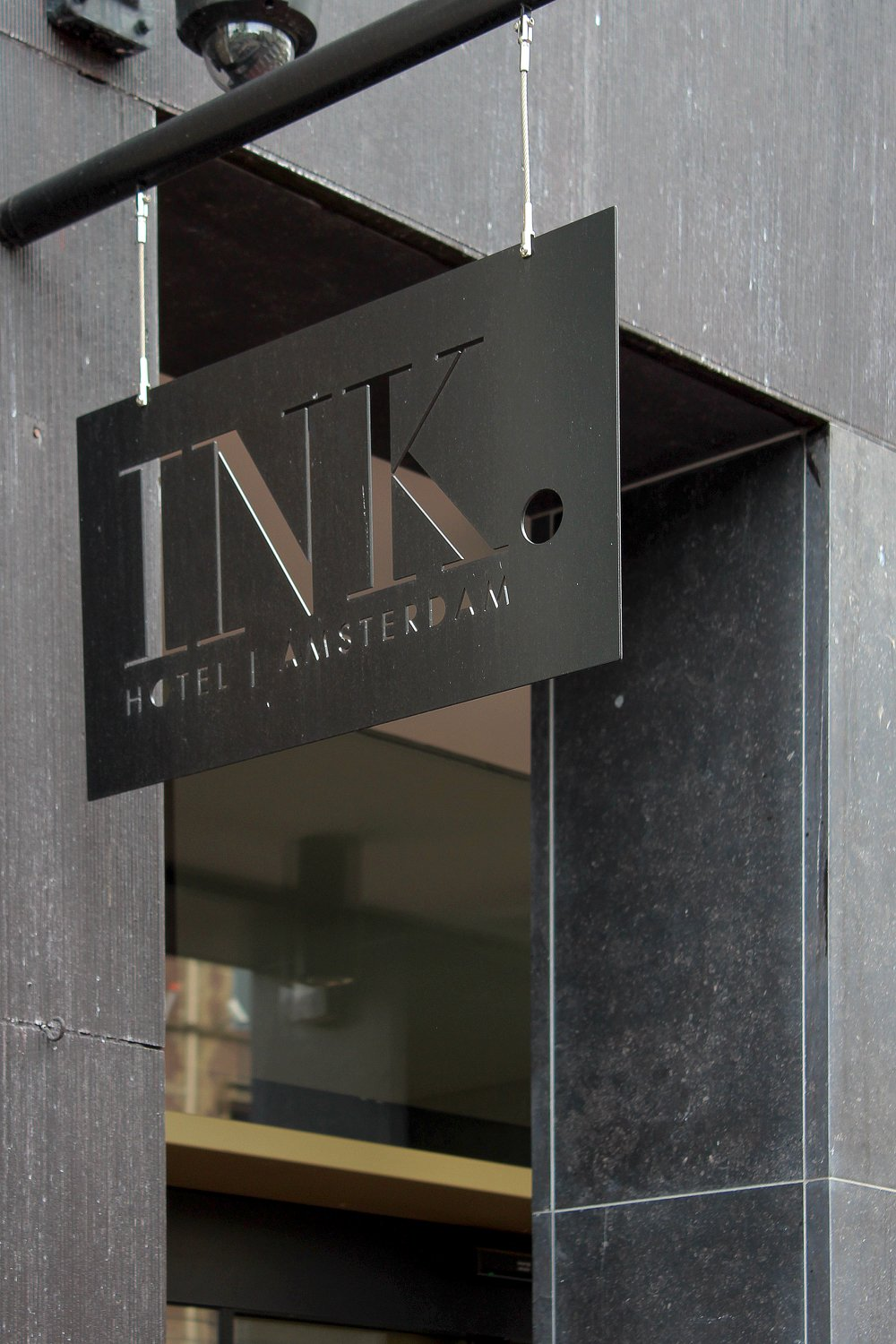 The entrance of the Ink Hotel Amsterdam on Nieuwezijds Voorburgwal