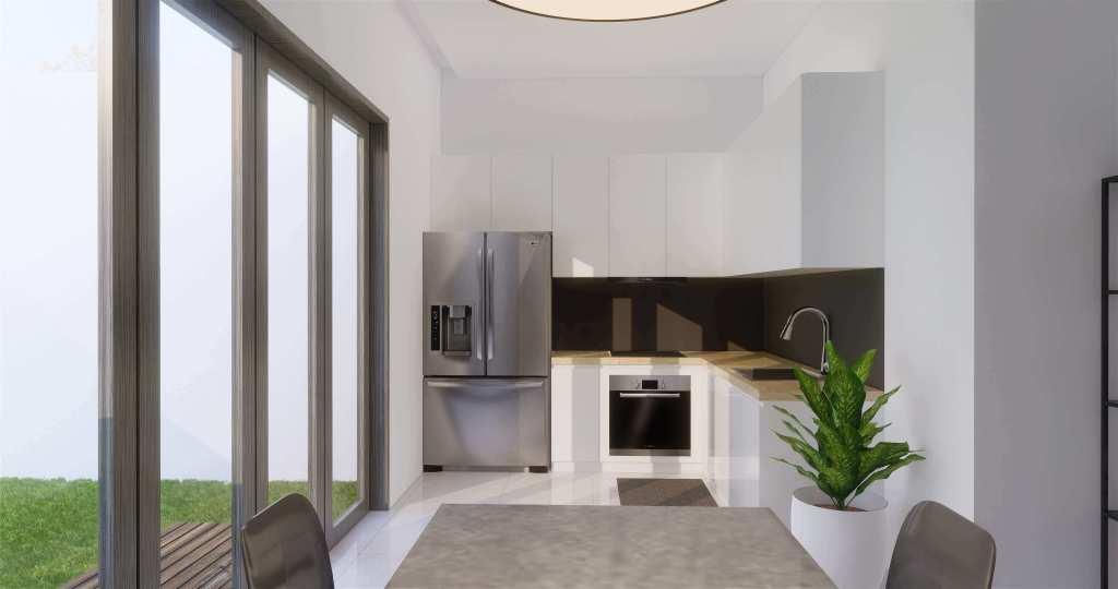 Dapur dengan gaya modern luxury dilengkapi furnitur minimalis dan tanaman hijau