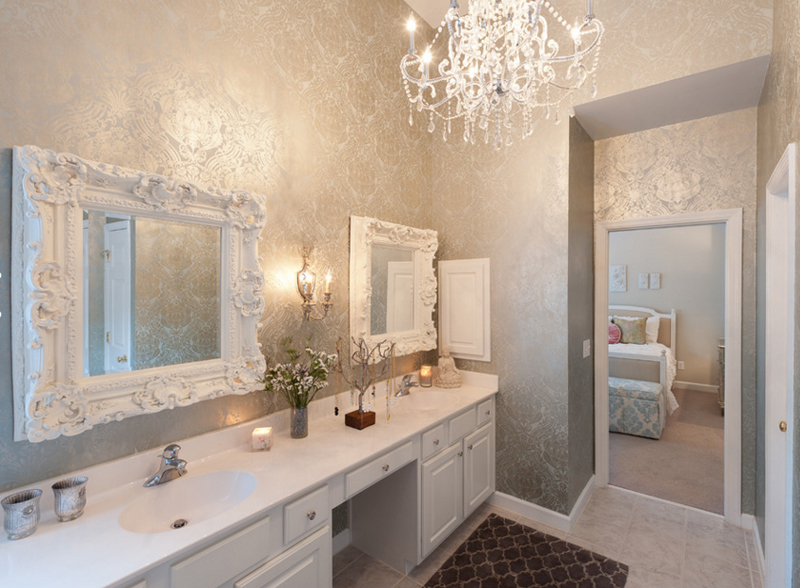 bathroom with chandeliers