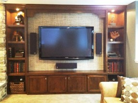 Custom Media cabinets are accented with grass- mat wall.