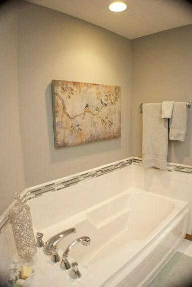 tile surround splash bath tub pull-out facet earth tones art bathroom