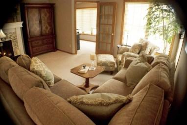 living room earthy tones wood armoire