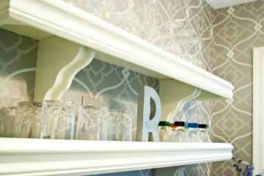 Shelves, wallpaper, and glasses