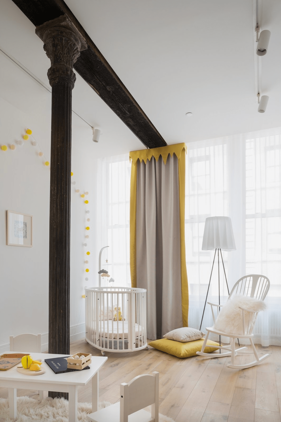 white and yellow baby room