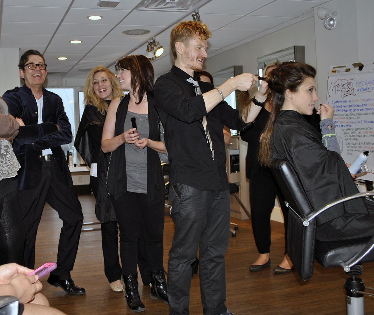 Stylists laughing during Shu Uemura education event at INTERLOCKS
