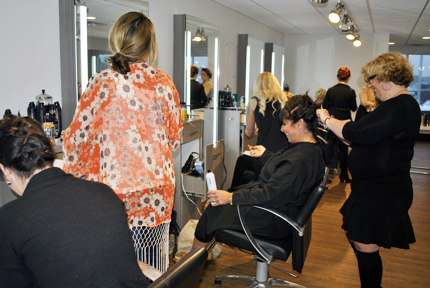 Stylists working on each other's hair at Shu Uemura event at INTERLOCKS
