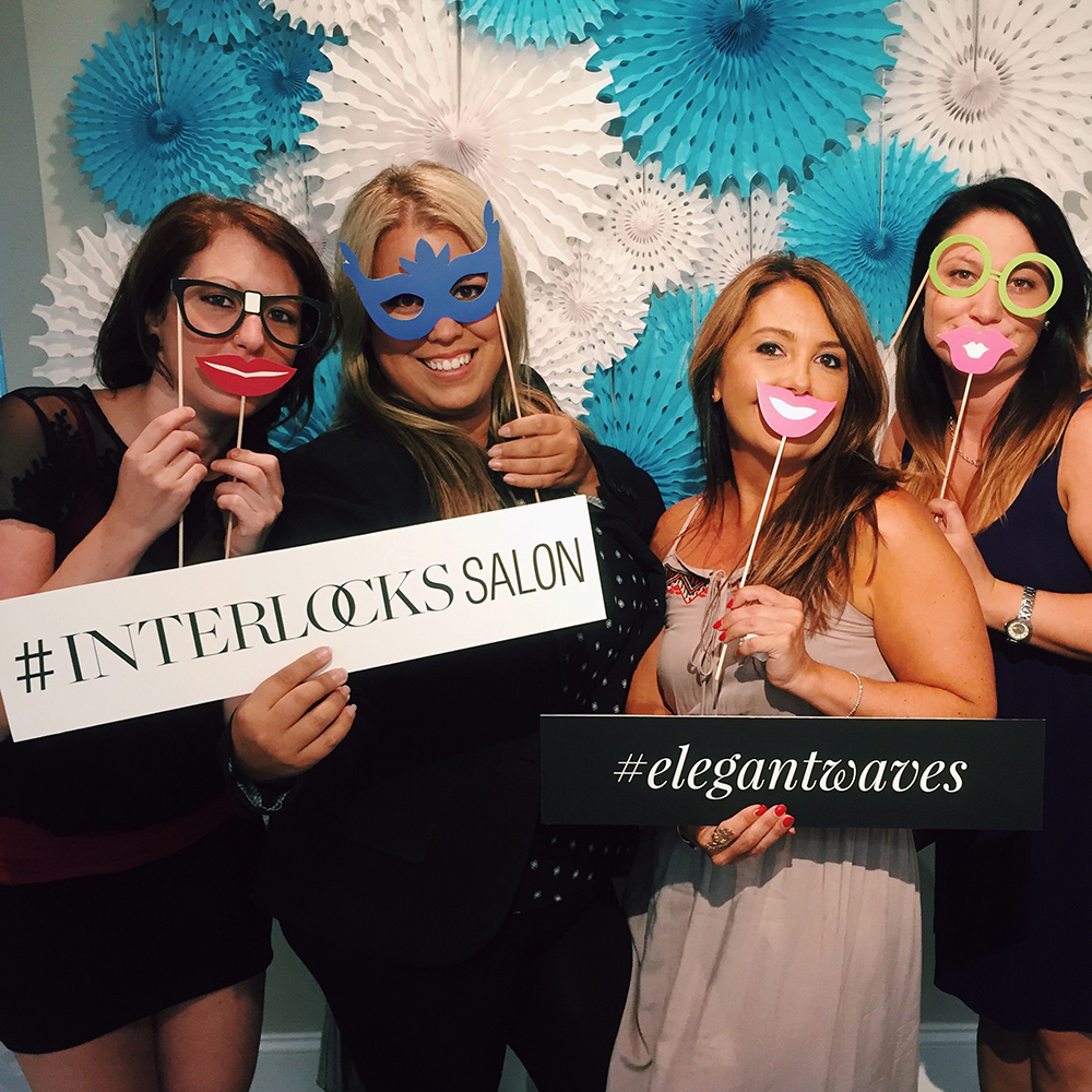 staff in photo booth before INTERLOCKS Effortless Summer hair and makeup event