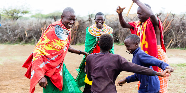 Kenyan people dance outside