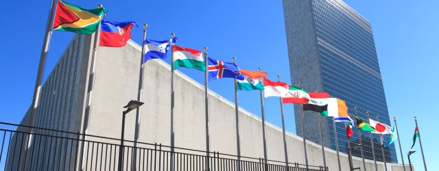 International flags fly in the wine in front of the the United Nations headquarters in New York City.