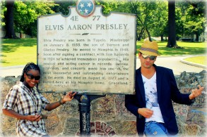 Standing at the gates of Graceland, the home of Elvis, in Memphis