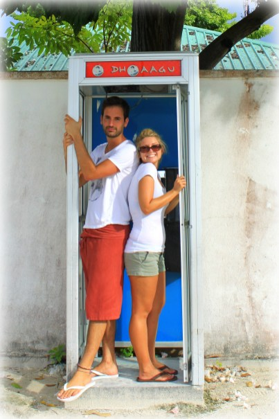 Me with my favorite travel partner in a telephone booth on the island of Gan in the Maldives