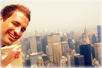 On top of the Empire State Building in NYC pointing at the old Pan Am building (now the MetLife Building)