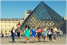 Trying to get the perfect jump shot with the crew in front of the Musée du Louvre