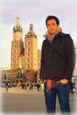 In Main Market Square in Kraków, Poland standing in front of St. Mary's Basilica