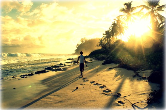 Strolling down a private beach on Mahé Island in The Seychelles off the coast of East Africa