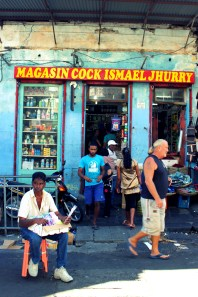 Colorful store fronts line the streets around the Port Louis Bazaar