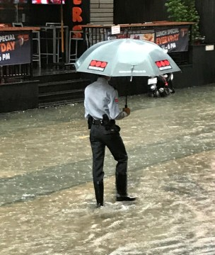 Officer wearing rubber boots.