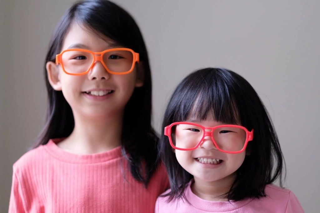 Two little sisters with big eyeglasses