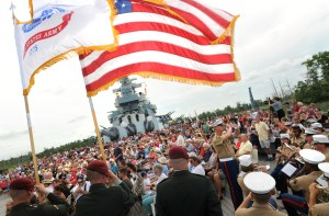 The All-Service Color Guard hold flags while the Second Marine Division Band plays during the recognition of the armed forces at the 45th annual Memorial Day Observance at the Battleship North Carolina in Wilmington Monday, May 31, 2010. For a gallery of photos from the event go to www.StarNewsOnline.com.     Staff Photo By Matt Born/Wilmington Star-News.