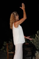Lena Melanidou Directing the Bi-Communal Choir for Peace in Cyprus at a performance.