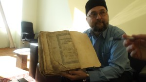 PHOTO/Madeleine Winer Ildar Muhhamedšin, imam of the Turath Islamic Center in Tallinn, Estonia, holds the Joran his grandparents passed down to him. He vowed to come back to Estonia after his university studies to carry on the heritage of the Muslim population in Estonia.