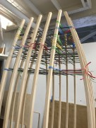 A grid of metal rods, held together by rubber bands.