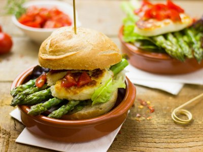 A healthy burger with asparagus, tomato, salad and a veggie patty served in a bowl. This could be a participating post for the healthy burger recipe competition.