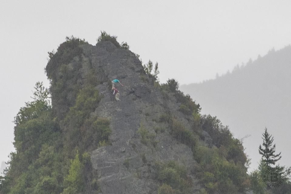 John and Ken climb the very treacherous south pinnacle of Chimney Tops.