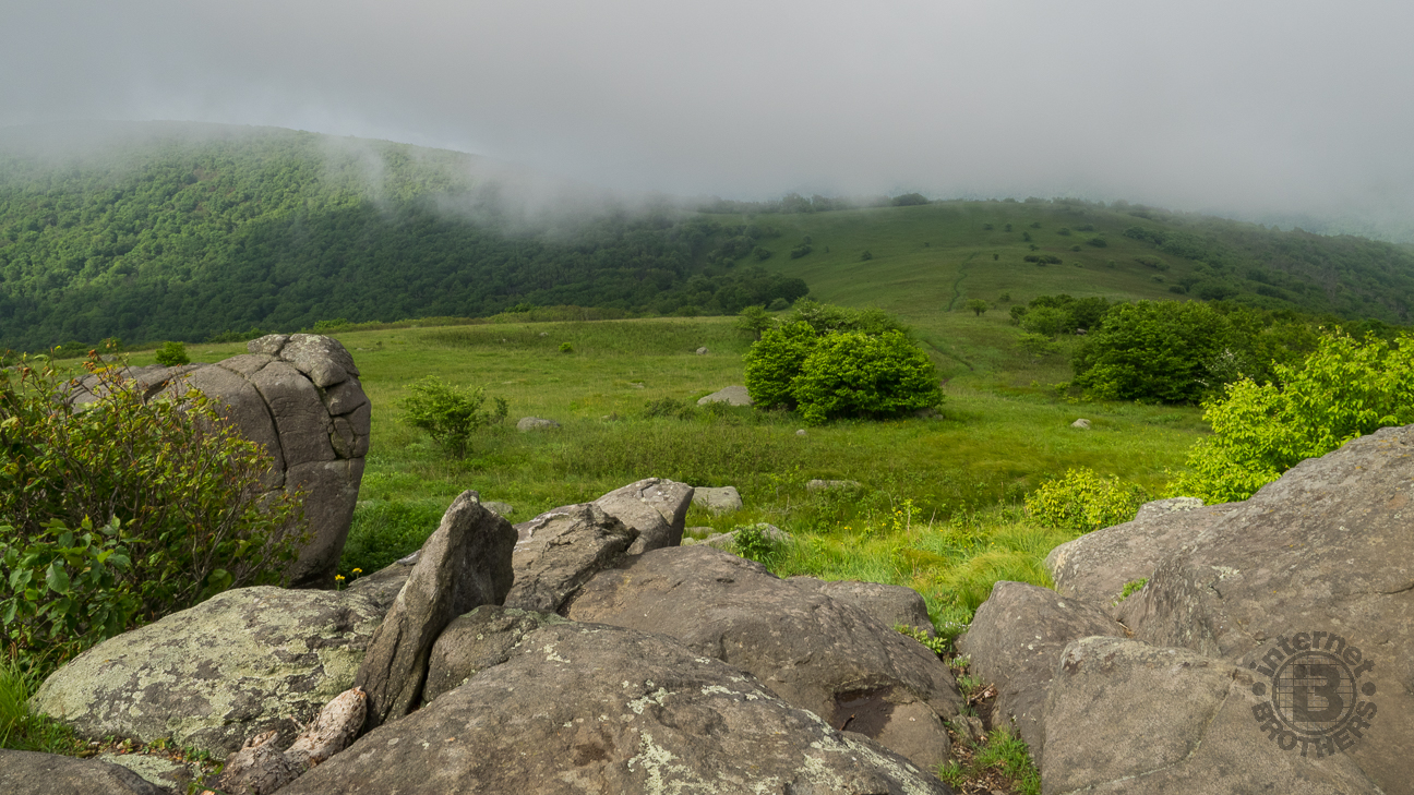 From the rock outcropping near the summit of Little Hump, fog obscures the view.