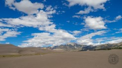 Sand, mountains, clouds, sky