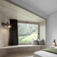A hiking hotel in the Alpine forest of Italy blends seamlessly into the landscape