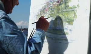 Von Meisterhand gemalt - Maler malt ein Bild
