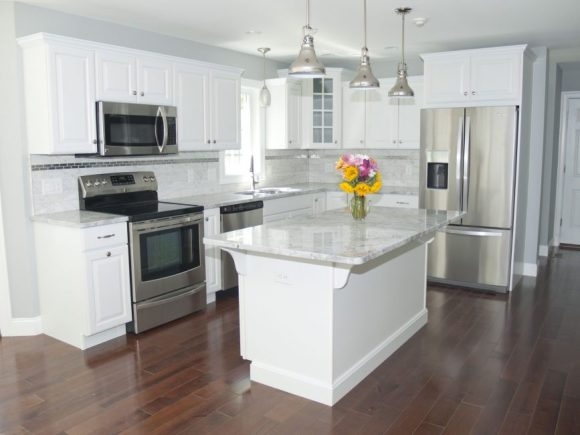 stainless steel appliances in white kitchen