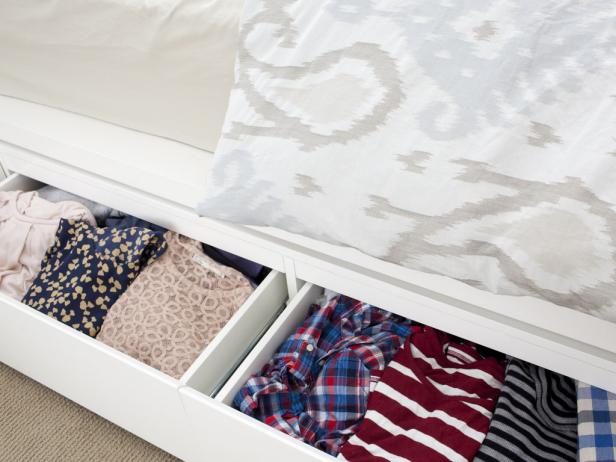 storing clothes under bed