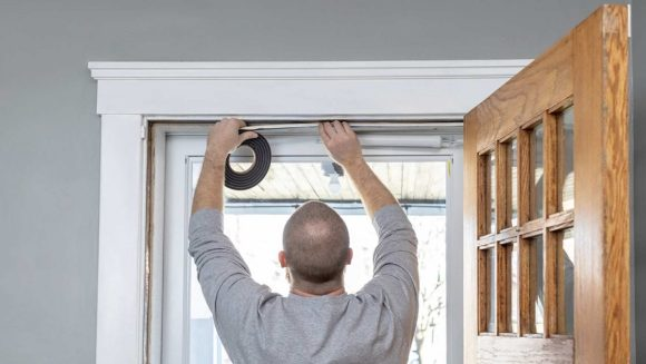 Magnetic weather stripping for wood doors