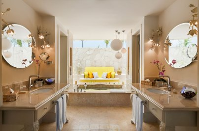 Eden Roc ---Coral-stone-bathrooms-with-marble-Jacuzzis