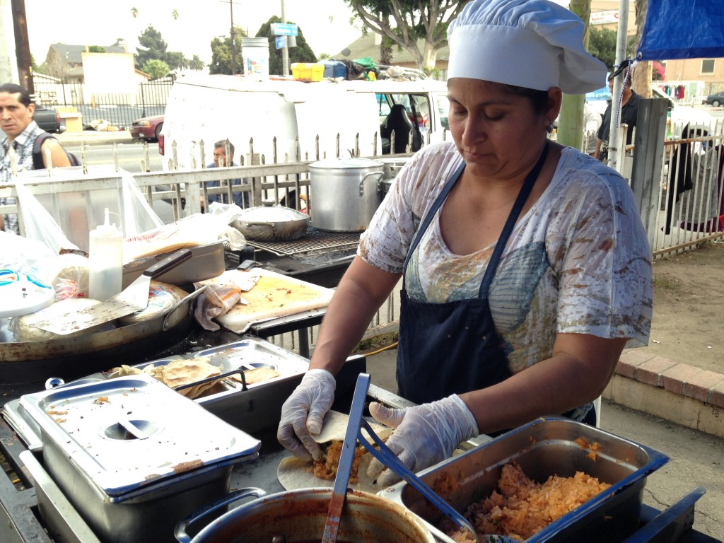 Felipa Mayo cooks tacos each weekend outside her home on Compton Boulevard. | Daina Beth Solomon