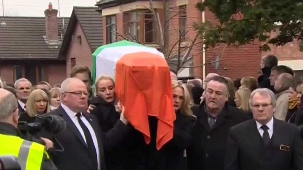 95288590 coffinleavinghouse - McGuinness funeral: Mourners gather in Derry